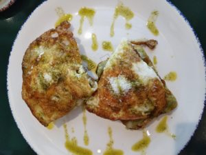 photo of well-done eggs cooked in coconut oil with avocado and almonds on gluten-free toast