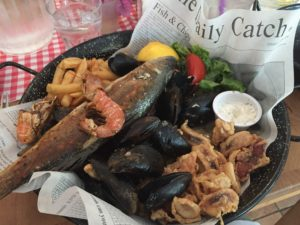 Picture of a delicious mixed seafood plate in Dubrovnik with mussels, squid, shrimp, fish, fries