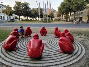 Blending in with Red Monks in a circle
